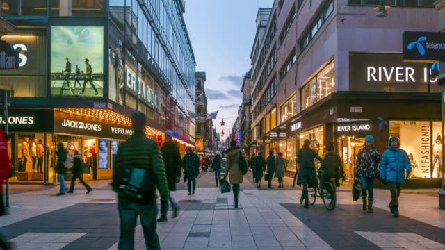 time lapse of people walking in shopping plaza - stockholm sweden - fare spese video stock e b–roll