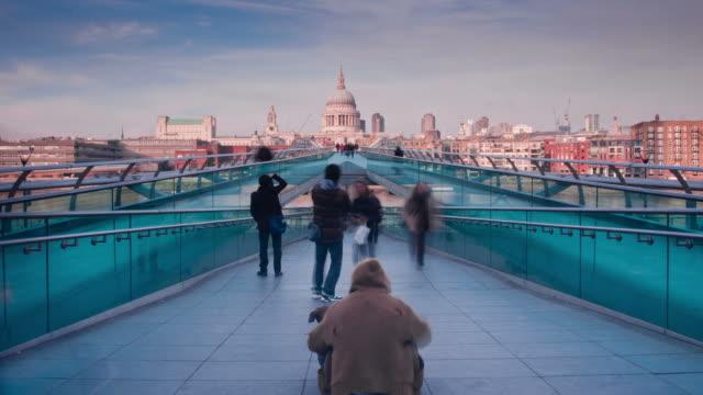 LONDON - CIRCA 2012:  Time lapse of people walking on the Millenium bridge in London circa 2012.
