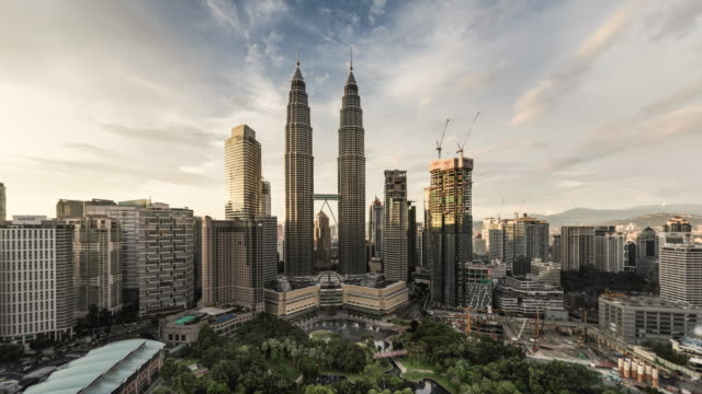 time lapse of petronas towers, elevated view, at dusk
