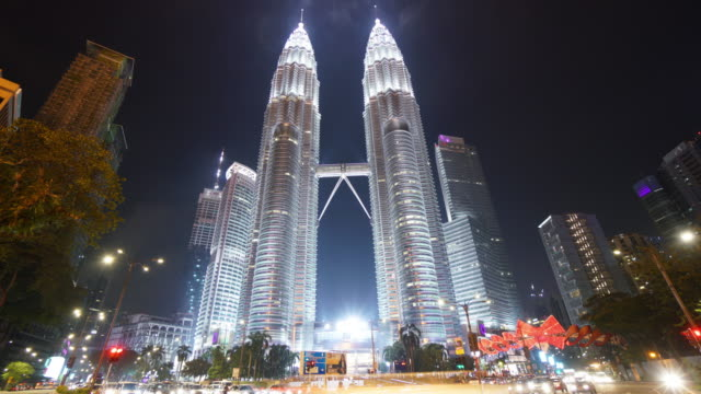 time lapse of petronas twin towers at night - petronas towers stock videos and b-roll footage