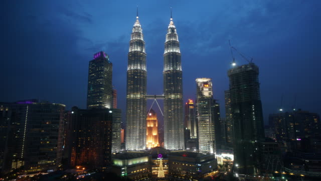 time lapse of petronas twin towers at night - petronas twin towers stock videos & royalty-free footage