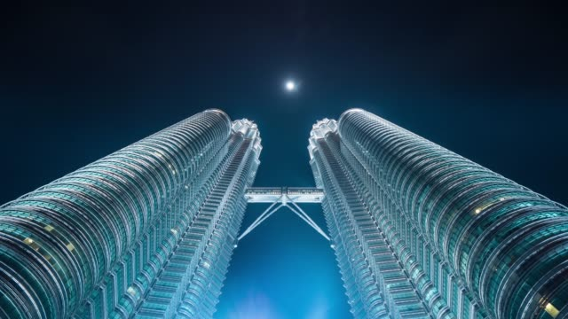 time lapse of petronas twin towers at night - kuala lumpur stock videos & royalty-free footage