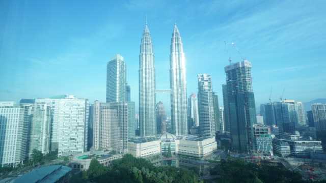 time lapse of petronas twin towers - petronas twin towers stock videos and b-roll footage
