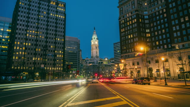 time lapse of philadelphia city hall at twilight time - clock tower stock videos & royalty-free footage