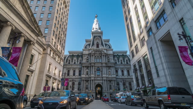 4k time lapse of philadelphia's landmark historic city hall among building and car traffic light with blue sky, pennsylvania, united states of america or usa, history and culture for travel concept - independence hall stock videos & royalty-free footage