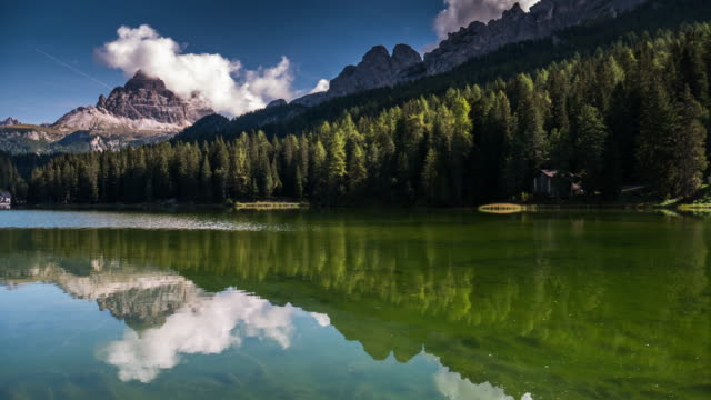 Time Lapse of Pine forest and mountain in Misurina lake dolomites Alpine Alps Italy south tyrol