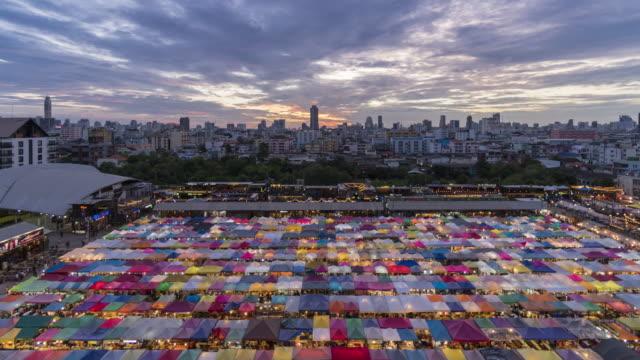 Time lapse of popular night market at Bangkok day to night