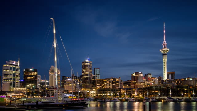 Time Lapse of port of auckland city day to dusk time twilight shot after sunset , new zealand