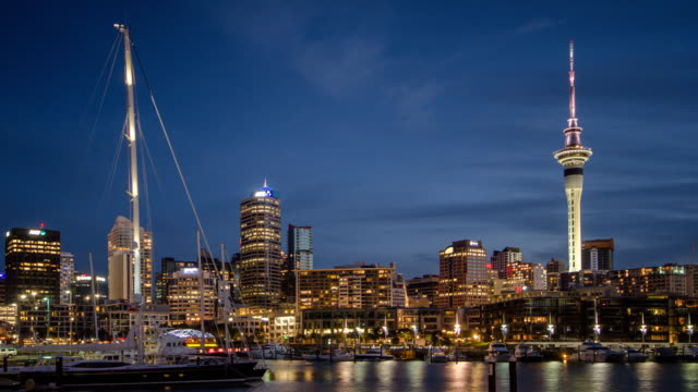 Time Lapse of port of auckland city day to dusk time twilight shot after sunset , new zealand , dolly shot left to right