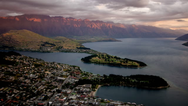time lapse of queenstown city day to dusk time twilight after sunset , otago , new zealand - queenstown stock videos & royalty-free footage