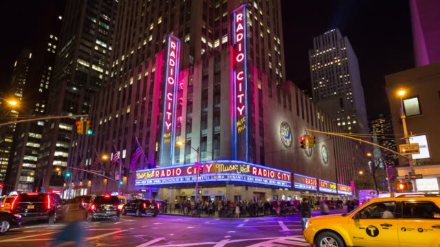 time lapse of radio city music hall at night, zoom out - radio city music hall stock videos & royalty-free footage