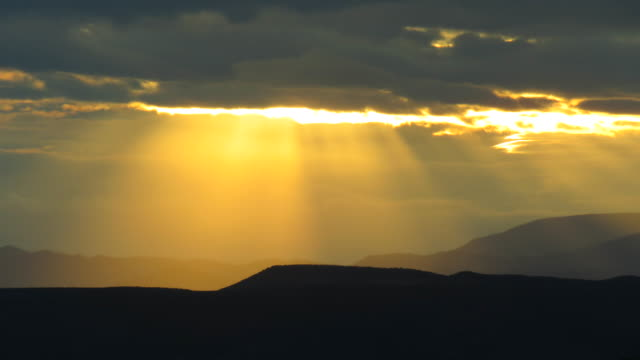 time lapse of rays of sunlight over santa fe mountains - santa fe new mexico stock videos & royalty-free footage
