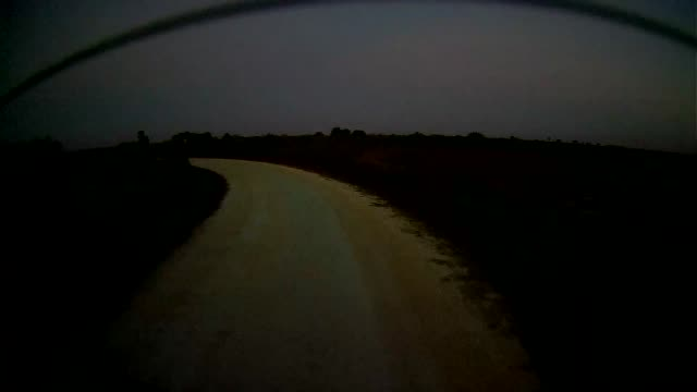 Time lapse of rear dashboard camera point of view of driving at twilight