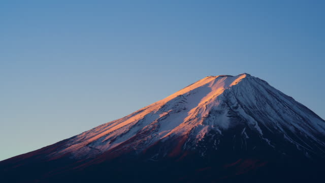 time lapse of red first sun light morning on top of fuji volcano peak, japan - mt fuji stock videos & royalty-free footage