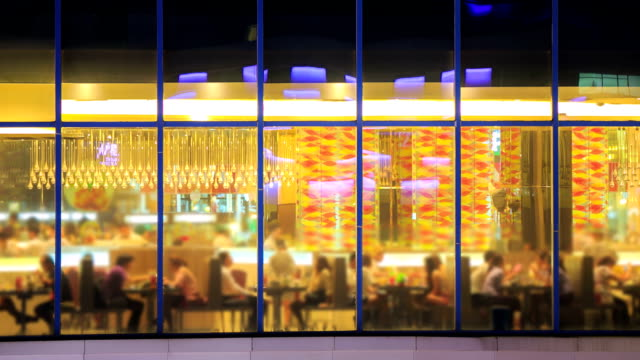 time lapse of restaurant cafe from outside at night - canteen stock videos & royalty-free footage