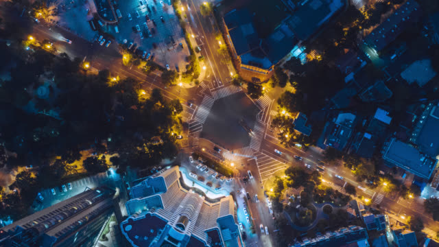 time lapse of road cross aerial view - liyao xie stock videos & royalty-free footage