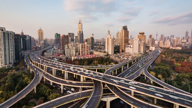 tl/ time lapse of road intersection, busy with rush hour commuter traffic, elevated view - traffic time lapse stock videos & royalty-free footage