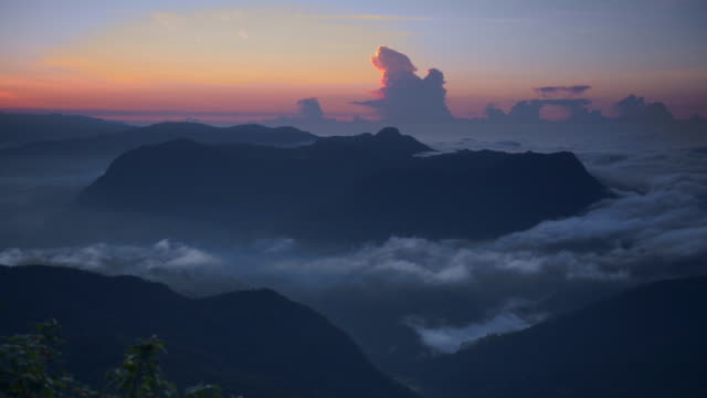 time lapse of rolling clouds from the 2443m summit of adams peak (sri pada) at sunrise, sri lanka highlands, asia  - sri lanka stock videos & royalty-free footage