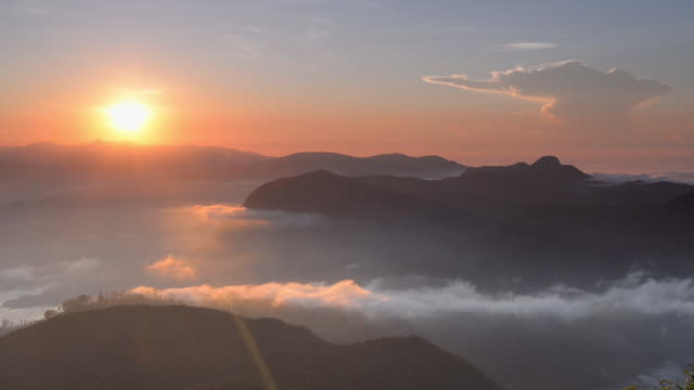 time lapse of rolling clouds from the 2443m summit of adams peak (sri pada) at sunrise, sri lanka highlands, asia  - sri lanka stock videos and b-roll footage