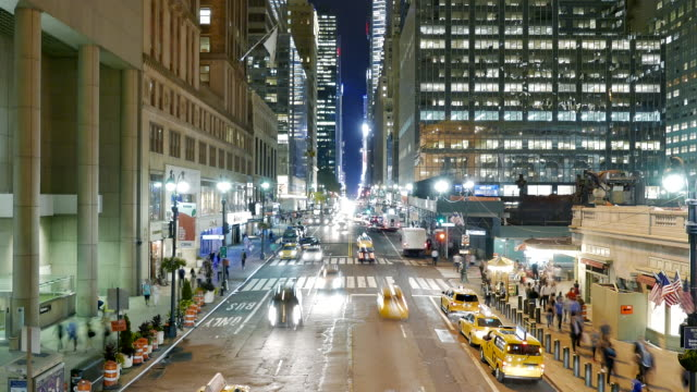time lapse of rush hour traffic commuting on busy street in the city at night