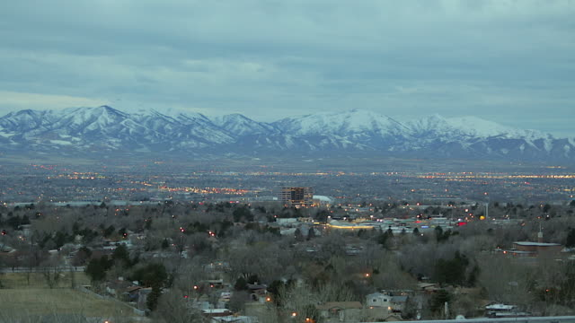 Time lapse of salt lake city valley evening turning in to night in winter