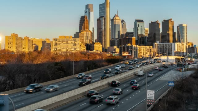4k time lapse of schuylkill expressway in rush hour at the evening time over the philadelphia pennsylvania cityscape background, united states, business architecture and transportation concept - independence hall stock videos and b-roll footage