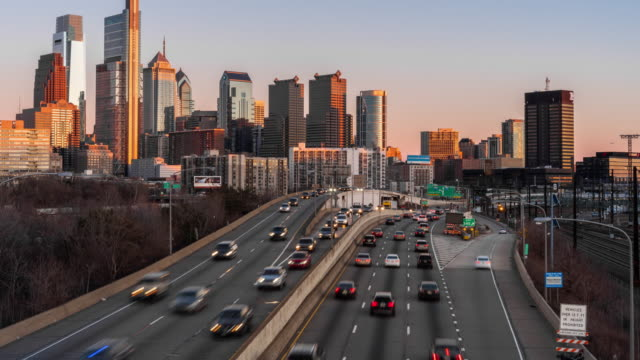 4k time lapse of schuylkill expressway in rush hour at the evening time over the philadelphia pennsylvania cityscape background, united states, business architecture and transportation concept - traffic time lapse stock videos & royalty-free footage