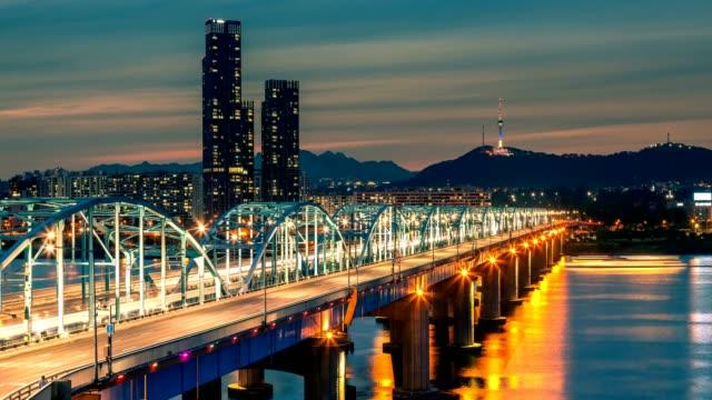 4K Time lapse of Seoul City skyline at Dongjak Bridge and Han river in Seoul, South Korea.