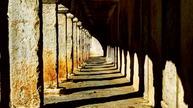 time lapse of shadow in ancient arcade corridor - column stock videos & royalty-free footage