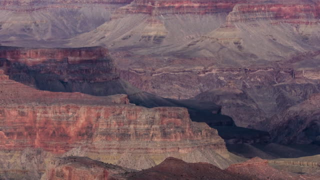 time lapse of shadows from clouds rolling over the eroded red rock landscape of the grand canyon, arizona - grand canyon national park stock videos & royalty-free footage