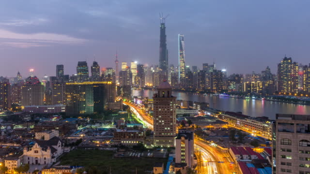 time lapse of shanghai pudong new area from sunset to night, china - sunset to night stock videos & royalty-free footage