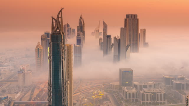 Time Lapse of Sheikh Zayed covered in a sea of fog at dawn