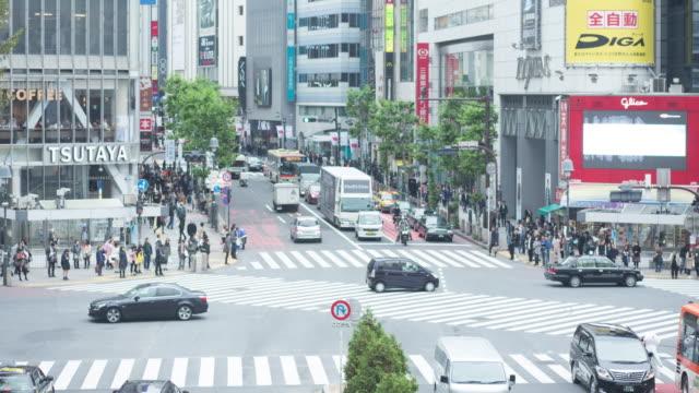 vídeos y material grabado en eventos de stock de lapso de tiempo de cruce de shibuya - paso de cebra