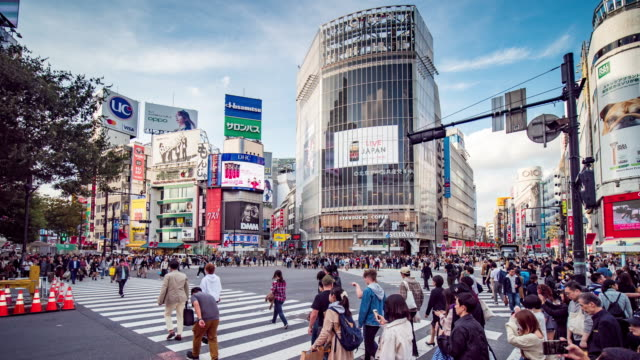 time lapse of shibuya intersection cross-walk with more people in rush hour , tokyo japan - fast motion stock videos & royalty-free footage