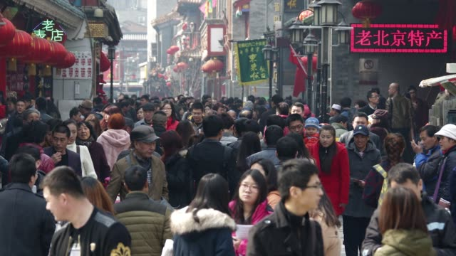 Time Lapse of shoppers and pedestrians walking through the Qianmen area of Beijing China on Saturday March 14 2015
