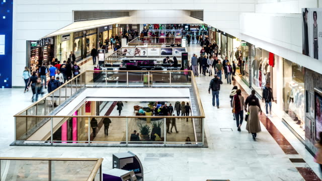 vidéos et rushes de time lapse of shoppers inside a shopping mall. - client