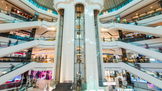 zeitraffer der shopping-mall rolltreppe - einkaufszentrum stock-videos und b-roll-filmmaterial