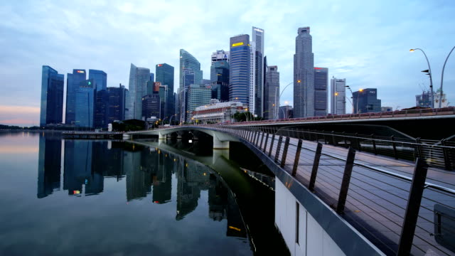 4k time lapse of singapore business center in the morning - footbridge stock videos & royalty-free footage