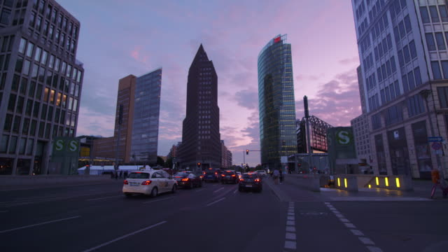 time lapse of skyscrapers and traffic at potsdamer platz with beautiful sunset. potsdamer platz, berlin, germany. - martin luther: his life and time stock videos & royalty-free footage