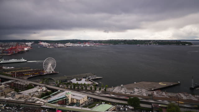 W/S time lapse of south Elliot Bay on a grey day as dark clouds roll in with Harbor Island and West Seattle in the background