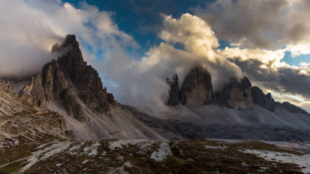 time lapse of spectacular moving cloud over mount paterno,dolomites - digital composite stock videos & royalty-free footage