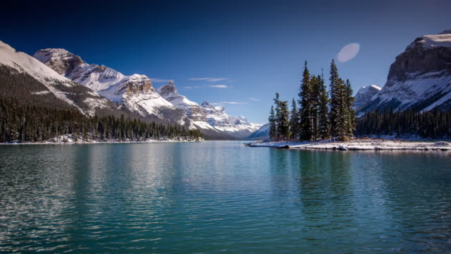 time lapse of spirit island maligne lake jasper national park , alberta canada - banff stock videos & royalty-free footage
