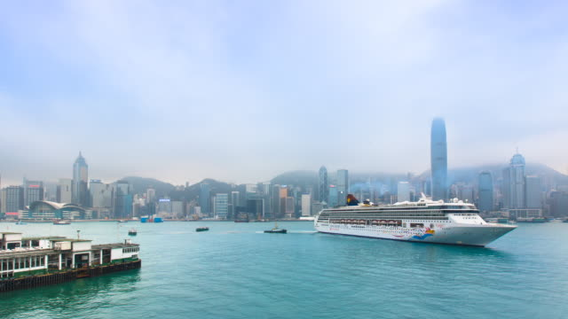 stockvideo's en b-roll-footage met time lapse of star ferry, cruise ship, hong kong skyline and victoria harbor - star ferry