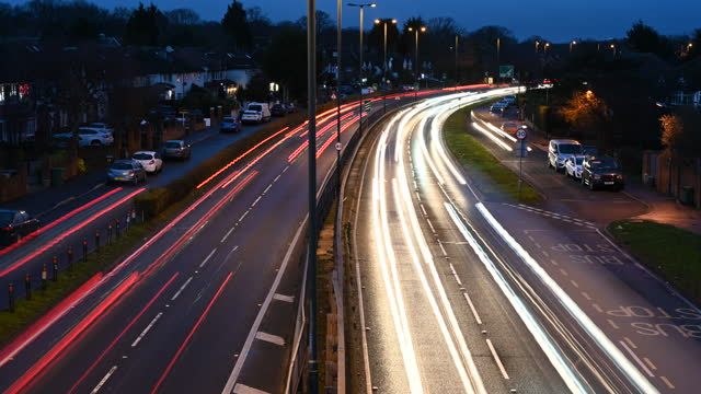 time lapse of suburban traffic moving on major roadway - light trail stock videos & royalty-free footage