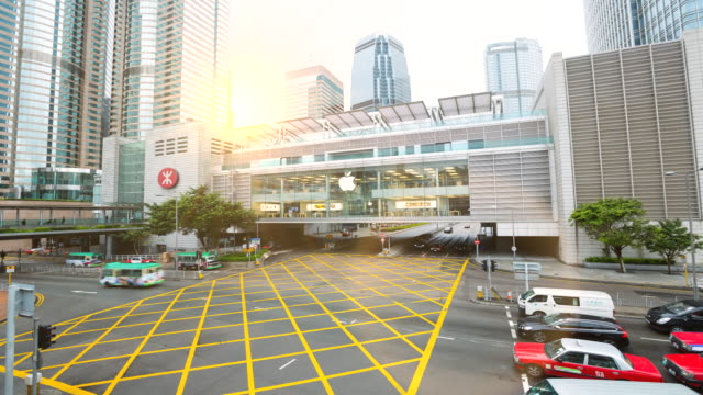 time lapse of sun rising over central hong kong business district - apple store stock videos & royalty-free footage
