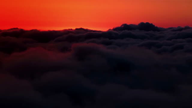 time lapse of sun setting behind moving cloudscape - nigeria stock videos & royalty-free footage