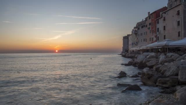 time lapse of sun setting on the adriatic sea, from old town, rovinj, istria, croatia, adriatic, europe - adriatic sea stock videos & royalty-free footage