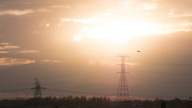 Time lapse of Sunrise and power line in Florida