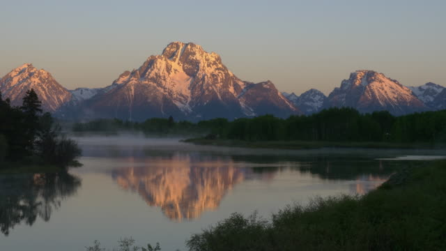 time lapse of sunrise and reflection at grand teton national park - grand teton stock videos & royalty-free footage