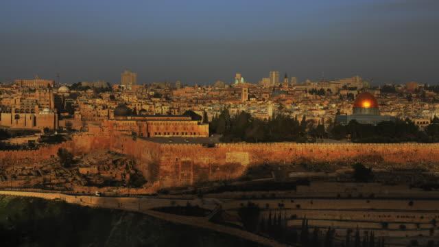 time lapse of sunrise and shadows over jerusalem - jerusalem stock videos & royalty-free footage